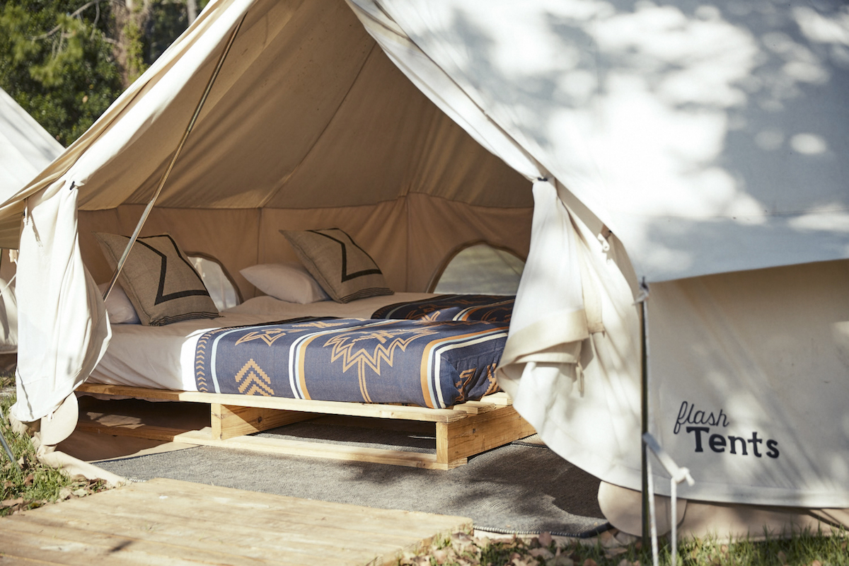 Flash Camp's spacious canvas Flash tents are furnished with a comfy double bed, or pair of singles.